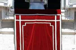 Pope Francis recites the Regina Coeli prayer from his studio's window overlooking St. Peter's Square at the Vatican, Sunday, May 28, 2017.