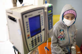 FILE - A young cancer patient is seen at a pediatric oncology clinic in Miami, Florida, Dec. 8, 2014.