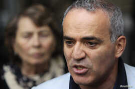 FILE - Former world chess champion and opposition leader Garry Kasparov speaks to the media after walking out of a court building in Moscow, Aug. 24, 2012.