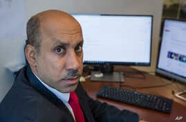 FILE - Ali AlAhmed poses for a photograph in his office in Washington on Oct. 26, 2018.