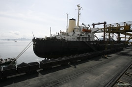 The Hong Ji ship from China gets coal at a port of the Cua Ong Coal Preparation Company in Cam Pha town, in Vietnam's northeast Quang Ninh province, September 21, 2010.