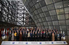 Officials pose for a group photo during a Syria donors conference at the European Council headquarters in Brussels,  March 14, 2019.