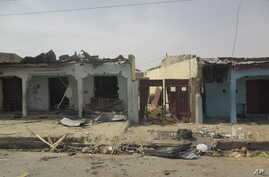 Victims of a suicide bomb explosion at a World Cup viewing center receive treatment at Sani Abacha specialist hospital  in Damaturu, Nigeria,  Wednesday, June 18, 2014. An explosion at an illegal World Cup viewing site in Damaturu northeast Nigeria k...