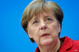 German Chancellor Angela Merkel attends a press conference after a party meeting at the headquarters of the German Christian Democratic Party in Berlin, Germany, Monday, March 14, 2016 one day after the elections in the German states of Saxony-Anhalt