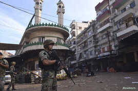 Lebanese army soldiers patrol Tripoli's Sunni Muslim Bab al-Tabbaneh neighborhood Oct. 27, 2014.