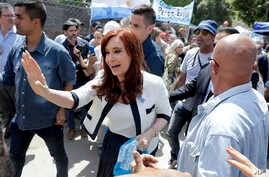 Argentina's former President Cristina Fernandez greets supporters outside a courthouse in Buenos Aires, Argentina,  Oct. 26, 2017.