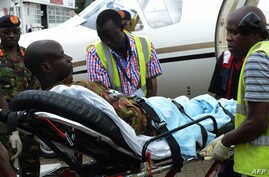 An injured Kenya Defense Force soldier is stretched into an ambulance to be transfered to the hospital after arriving in Nairobi, on January 17, 2016, a day after an attack by the al-Qaeda-linked militants on an African Union base (AMISOM) in southwe...