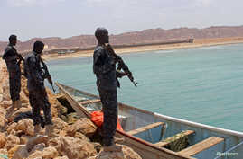 FILE - Somali Puntland forces are seen on the shores of the Gulf of Aden in Bosasso, Puntland region, Somalia, Sept. 23, 2017.