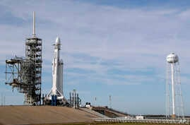 A Falcon 9 SpaceX heavy rocket stands ready for launch on pad 39A at the Kennedy Space Center in Cape Canaveral, Fla., Feb. 5, 2018.