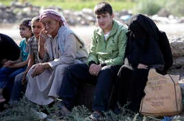 Syrian refugees gather in the village of Salkin after crossing the Syrian-Turkish border, Sept. 5, 2013.