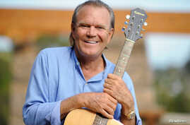 FILE = Recording artist Glen Campbell is photographed at his home in Malibu, California, Aug. 4, 2008.