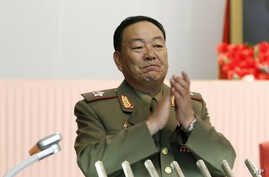 FILE - Recently executed then-Vice Marshal Hyon Yong Chol applauds during a meeting at the April 25 House of Culture announcing North Korean leader Kim Jong Un's new title of marshal.