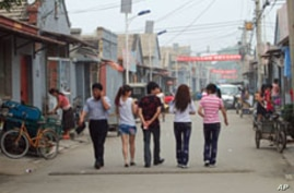 Chinese Migrant Workers Walled Off From Society