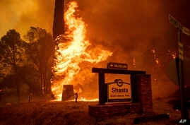 The Carr Fire tears through Shasta, Calif., July 26, 2018. Fueled by high temperatures, wind and low humidity, the blaze destroyed multiple homes and at least one historic building.