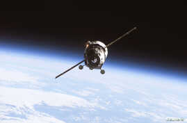 With the Earth's horizon in the background, an unmanned Progress supply vehicle approaches the International Space Station in this undated photograph obtained on July 3, 2010. Space Station Program officials from NASA and Roscosmos have agreed to pro