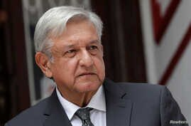 Mexico's incoming President Andres Manuel Lopez Obrador speaks to the media during a news conference at his campaign headquarters in Mexico City, Aug. 10, 2018.