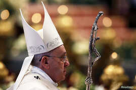 Pope Francis leaves after he celebrates the New Year mass in Saint Peter's Basilica at the Vatican, Jan. 1, 2015.