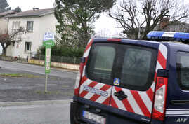 A French police vehicle is parked near a house where an alleged jihadist was arrested earlier on December 15, 2014, in Graulhet, southwestern France.