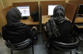 Iranian women use computers at an Internet cafe in central Tehran, Iran on Feb. 13, 2012. Many Iranian users are reporting Gmail and other Google products have been blocked.
