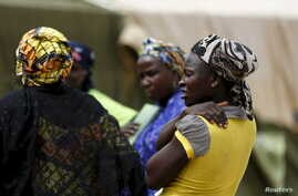 Women gather at a camp for Internally Displaced People as more women and children rescued from Sambisa arrive in the camp in Yola, Nigeria May 3, 2015.