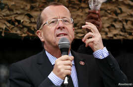 FILE - U.N. special envoy to Congo, Martin Kobler, addresses troops outside Goma in the eastern Democratic Republic of Congo, Aug. 31, 2013.