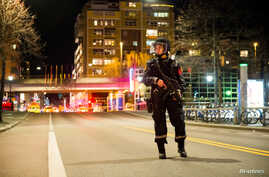 "Police blocked off an area in central Oslo and arrested a man after the discovery of ""bomblike device,"" in Oslo, Norway, April 8, 2017."