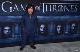 """FILE - Peter Dinklage attends the season six premiere of  """"Game Of Thrones"""" at TCL Chinese Theatre in Los Angeles, California, April 10, 2016."""