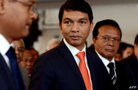 Madagascar's transitional leader Andry Rajoelina (C) attends a ceremony at Antananarivo's Town Hall, on May 13, 2013 to commemorate the students' unrest of May 13 1972 which led to the first Republic's fall.