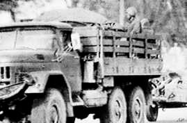 FILE - A truck carrying Soviet troops and trailering weapons moves through a Kabul street in this photograph taken from a monitor of a CBS Evening news Broadcast, Dec. 31, 1979.