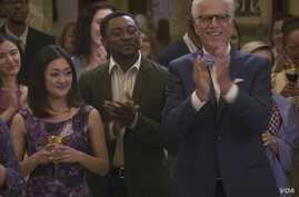 "Actor Bambadjan Bamba is seen alongside Ted Danson in this NBC publicity photo for the TV Show ""The Good Place."""