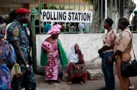 Gambians wait to cast their vote at a polling station in Banjul, Gambia, Dec. 1, 2016.