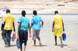 Ethiopian migrants walk after arriving to Yemen's shore on a smugglers boat in the southern province of Shabwa, Yemen, Aug. 11, 2017.