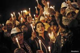 Supporters of Aam Aadmi, or Common Man, Party (AAP) participate in a candle light vigil during a protest against the rape of a female passenger, in New Delhi, Dec. 8, 2014.