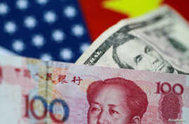 FILE - U.S. dollar and China yuan notes are seen in this illustration, June 2, 2017. This June, the yuan is set for its biggest monthly fall on record.