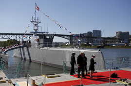The autonomous ship Sea Hunter, developed by the Pentagon's Defense Advanced Research Projects Agency, is shown docked after its christening ceremony in Portland, Oregon, April 7, 2016.