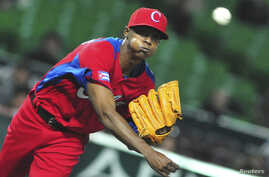 Cuba's Raciel Iglesias pitches a ball during the last preparation game for the World Baseball Classic (WBC) in Fukuoka in this March 1, 2013 file photo.
