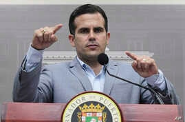 Puerto Rico Gov. Ricardo Rossello speaks during a press conference regarding the number of estimated deaths in the aftermath of Hurricane Maria, in San Juan, Puerto Rico, Tuesday, Aug. 28, 2018.