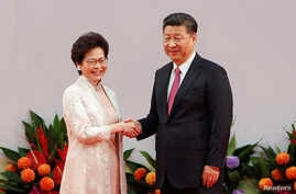 Hong Kong Chief Executive Carrie Lam shakes hands with Chinese President Xi Jinping after she swore an oath of office on the 20th anniversary of the city's handover from British to Chinese rule, in Hong Kong, China, July 1, 2017.