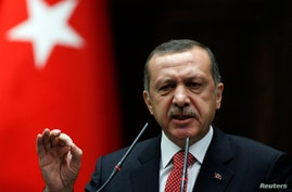Turkey's Prime Minister Tayyip Erdogan addresses members of parliament from his ruling AK Party (AKP) during a meeting at the Turkish parliament in Ankara June 26, 2012. The Turkish Armed Forces' rules of engagement have changed as a result of Syria