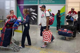 Members of the Russian Olympic delegation wheel past with their luggage after arriving at the Rio de Janeiro International Airport to compete at the 2016 Summer Olympics in Rio de Janeiro, Brazil, July 29, 2016.
