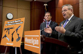 Sen. Bob Menendez, D-N.J., right, accompanied by Sen. Richard Blumenthal, D-Conn., left, speaks at a news conference on an proposed amendment to ban high capacity magazines in guns, on Tuesday, Feb. 12, 2019, in Washington.