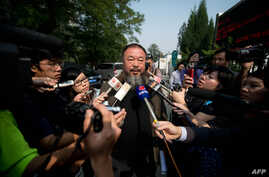 Outside a court in Beijing, Chinese artist Ai Weiwei (C) talks to the foreign media says the court rejected his appeal regarding a $2.4 million fine for tax evasion, Sept. 27, 2012.