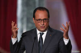 French President Francois Hollande attends his news conference at the Elysee Palace in Paris, France, Sept. 7, 2015.