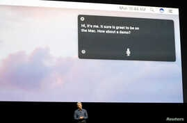 FILE - Craig Federighi, Senior Vice President of Software Engineering for Apple Inc, discusses the Siri desktop assistant for Mac OS Sierra at the company's World Wide Developers Conference in San Francisco, California, U.S.