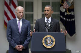 President Barack Obama, accompanied by Vice President Joe Biden, speaks in the Rose Garden of the White House, June 25, 2015, in Washington, after the U.S. Supreme Court upheld the subsidies for customers in states that do not operate their own excha