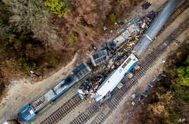 An aerial view of the site of an early morning train crash Feb. 4, 2018, between an Amtrak train, bottom right, and a CSX freight train, top left, in Cayce, SC. The Amtrak passenger train slammed into a freight train in the early morning darkness Sun