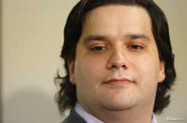 FILE - Mark Karpeles, chief executive of Mt. Gox, attends a news conference at the Tokyo District Court in Tokyo, February 28, 2014.