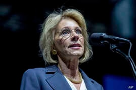 President-elect Donald Trump's pick for Education Secretary Betsy DeVos speaks during a rally at DeltaPlex Arena, Friday, Dec. 9, 2016, in Grand Rapids, Mich.