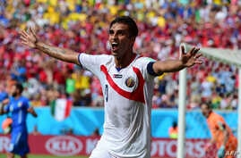 Costa Rica's forward Bryan Ruiz celebrates after scoring his team's first goal during a Group D match between Italy and Costa Rica at the Pernambuco Arena in Recife during the 2014 FIFA World Cup in Brazil, June 20, 2014.