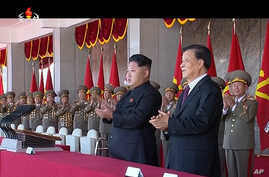North Korean leader Kim Jong Un, center, along with Liu Yunshan, China's Communist Party's No. 5 leader, second right, claps hands during the ceremony to mark the 70th anniversary of the country's ruling party in Pyongyang, October 10, 2015.